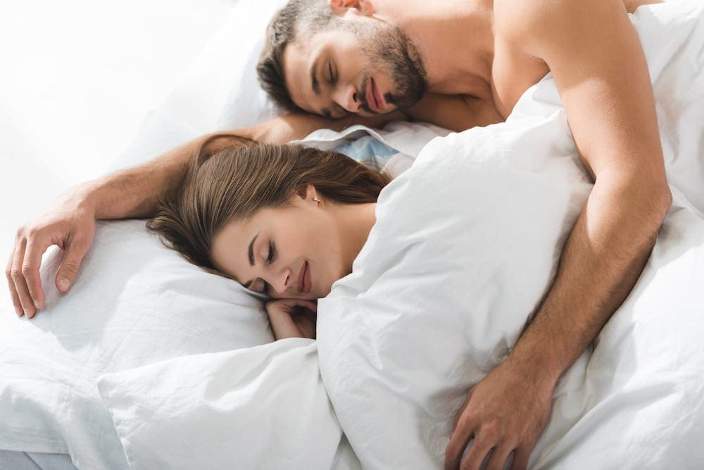 couple sleeping next technology